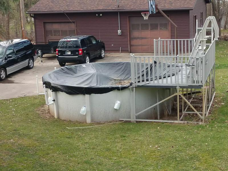 Photo 16 Round above ground pool with deck