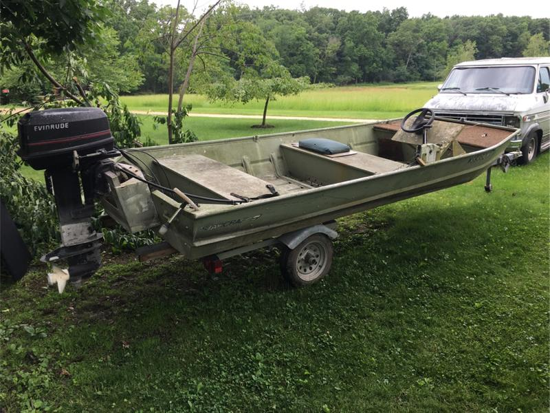 Photo 1993 Starcraft 15ft flat bottom shallow water boat. Steering wheel cables with controls and nice 3yr old trailer. 25 hp motor runs but needs carb work