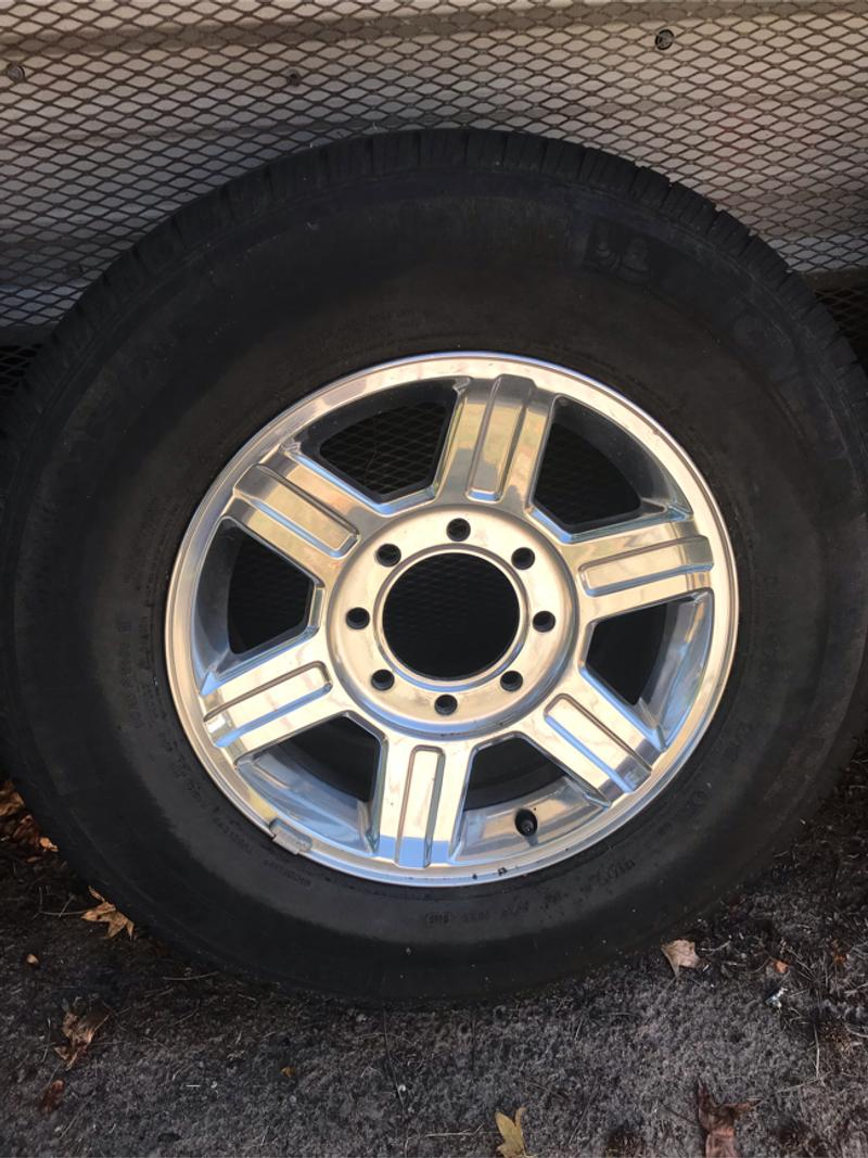 Photo Set of 4 tires and wheels.. hubcaps and lugs