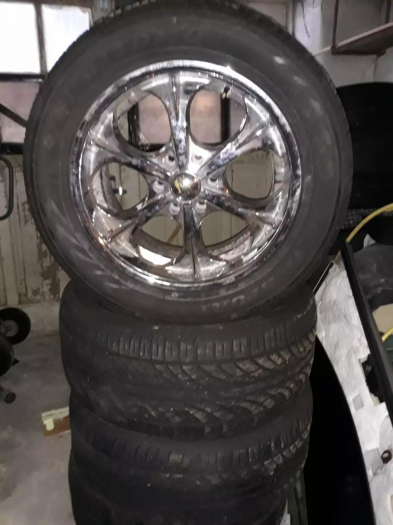 Photo 20 inch rims and tires for sale or trade does not fit my Chevy Tahoe