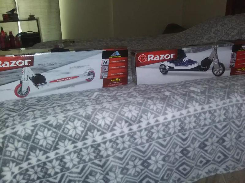 Photo 2 brand new razor scooters in original box never been open or used