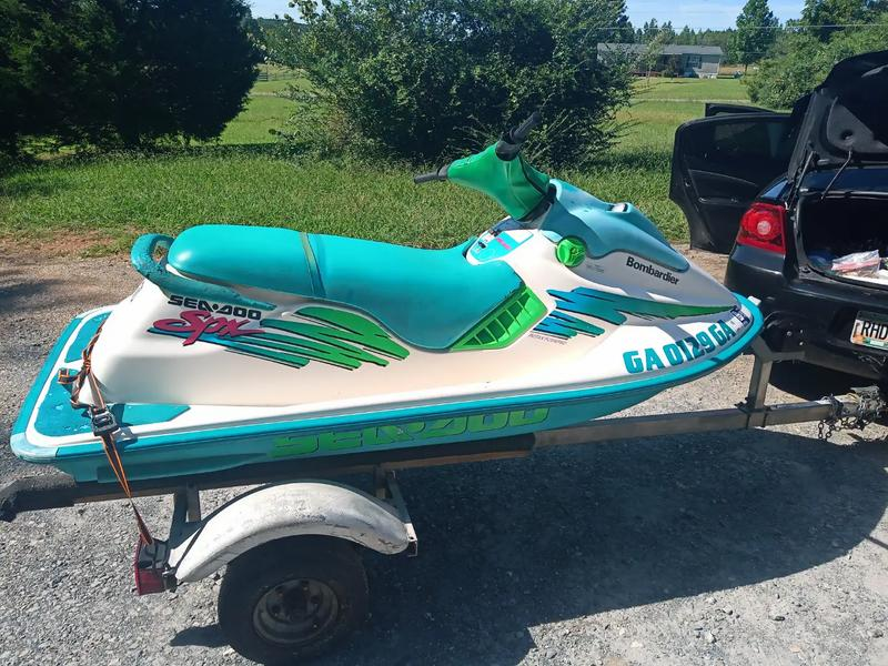 Photo 94 SeaDoo spx 657x runs and drives got another one dont need this one lots of new parts New battery new plugs new rotory valve timing gear new wearing carbs rebuilt comes with trailer