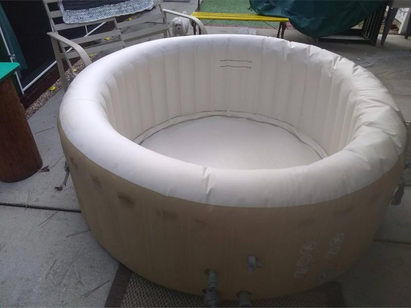 Photo Salu spa soft tub with all accessories and chemicals! Just one year old! Includes spa, filter pump, cover, and all necessary filters and chemicals