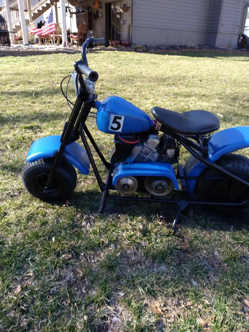 Photo It is a vintage mini bike,it also has new tires , runs on a 5 .hp gas motor. It needs the carb. Cleaned. Its really fast. 45 mph.