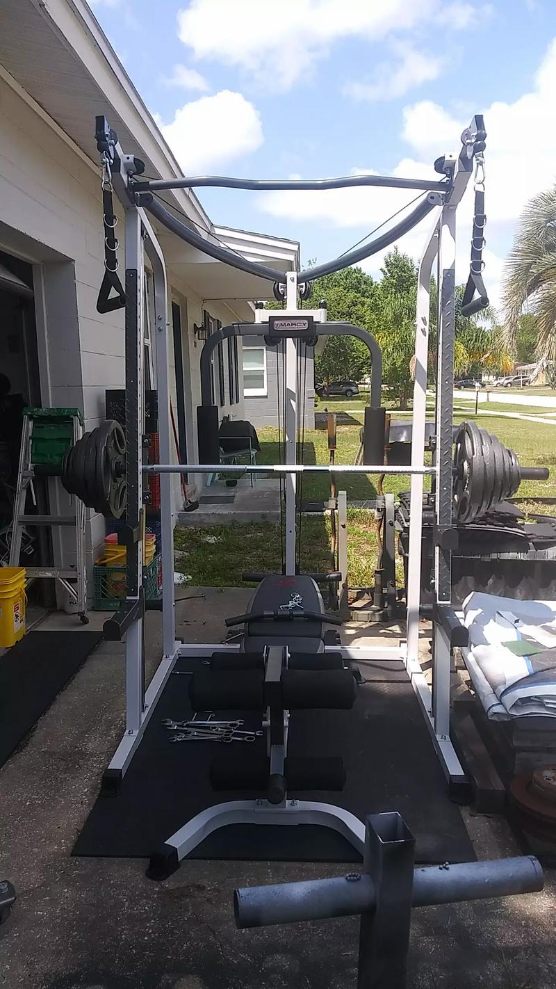 Photo smith machine home gym 255 lbs of grip weights all new $1500 cash$1,500deltona
